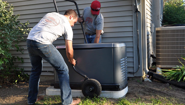 Gary and Bernardo finishing the installation of their generator shelter.